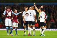 Tottenham's Jan Vertonghen is shown a yellow card - Aston Villa vs. Tottenham Hotspurs - Barclay's Premier League - Villa Park - Birmingham - 02/11/2014 Pic Philip Oldham/Sportimage