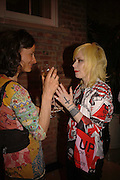 MARCHIONESS OF WORCESTER AND PAM HOGG, Champagne reception celebrating 100 years of Chinese cinema  hosted by Hamish McAlpine of Tartan Films, Raising money for Care For Children, a foster care programme in China. Aspreys. New Bond St. London. 25 April 2006. ONE TIME USE ONLY - DO NOT ARCHIVE  © Copyright Photograph by Dafydd Jones 66 Stockwell Park Rd. London SW9 0DA Tel 020 7733 0108 www.dafjones.com