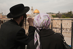 Middle East, Israel, Jerusalem, Hasidic Jewish couple above the Western Wall, with Dome of the Rock in the distance