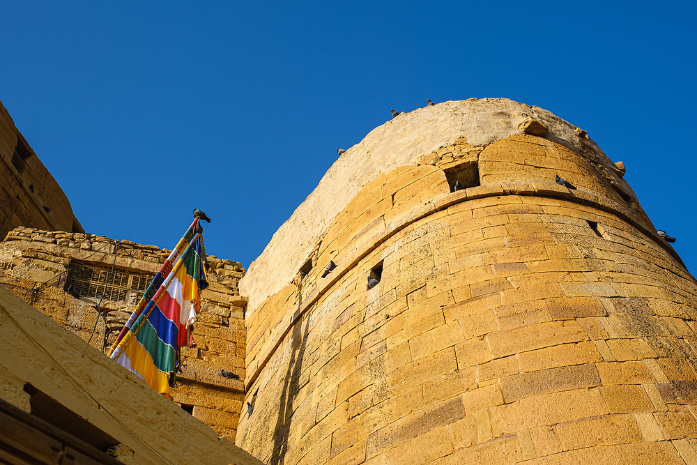 """JAISALMER, INDIA - CIRCA NOVEMBER 2018: View Jaisalmer Fort.  Jaisalmer is also called """"The Golden City, and it is located in Rajasthan. . The town stands on a ridge of yellowish sandstone, and is crowned by the ancient Jaisalmer Fort."""