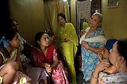 Swaran Kaur, 80, (3rd from right) Harjinder Kaur, 57, (right) Nirmal Kaur, 32 (third from left) and   Surinder Kaur, 65,  (second from left) are talking in Harjinder's home in Tilak Vihar, New Delhi, India. They have all lost their husbands and other members of their families during the anti-Sikh riots erupted in New Delhi in 1984 in the light of Indira Gandhi's assassination by her Sikh bodyguards.