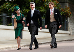The Princess Royal and Vice Admiral Sir Tim Laurence arrives for the wedding of Princess Eugenie to Jack Brooksbank at St George's Chapel in Windsor Castle.