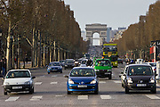 Three Renault French cars stop at pedestrian crossing on Champs-Élysées, Paris, France