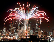 Fireworks blast off from The Space Needle during a practice run for the New Year's Eve show.<br /> Jim Bates / The Seattle Times