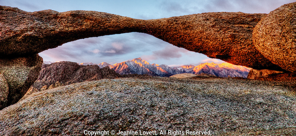 A thin granite arch giving an opening to Mount Whitney. California, Alabama Hills is were many Hollywood westerns were filmed.