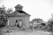 """Y-680604-B06.  Octagonal Shell gas station, known as """"The Roundhouse"""" at its original location between the old hotel and the railroad tracks. It was later moved to Highway 99E, restored and declared a historic building in Aurora. Afterward, it was renamed the Octagonal building and moved again behind the Colony Store And Hall, at the intersection of Main & 2nd St. NE. Aurora, Oregon. June 4, 1968"""