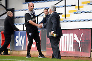 Paul Cook, the Portsmouth manager shakes hands with Iain McInnes, the Portsmouth chairman after the final whistle. Skybet football league two match, Cambridge Utd v Portsmouth at the Abbey Stadium  in Cambridge on Saturday 10th October 2015.<br /> pic by John Patrick Fletcher, Andrew Orchard sports photography.