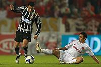 20090701: PORTO ALEGRE, BRAZIL - Internacional vs Corinthians: Brazilian Cup 2009 - Final - 2nd Leg. In picture: Andre Santos (Corinthians) and Magrao (Internacional). PHOTO: CITYFILES