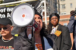 November 10, 2018 - Manhattan, New York, United States - A protester is seen speaking on a megaphone during the demonstration..Hundreds of protesters gathered at Washington Square Park in Manhattan to demand President Trump & Vice President Pence's resignation during Trump/Pence Regime must go protest. (Credit Image: © Ryan Rahman/SOPA Images via ZUMA Wire)