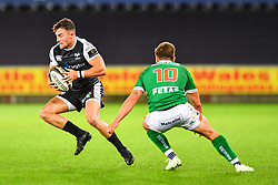 Luke Morgan of Ospreys evades the tackle of Antonio Rizzi of Benetton Treviso<br /> <br /> Photographer Craig Thomas/Replay Images<br /> <br /> Guinness PRO14 Round 4 - Ospreys v Benetton Treviso - Saturday 22nd September 2018 - Liberty Stadium - Swansea<br /> <br /> World Copyright © Replay Images . All rights reserved. info@replayimages.co.uk - http://replayimages.co.uk