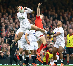 Jonny May of England spills the high ball<br /> <br /> Photographer Simon King/Replay Images<br /> <br /> Six Nations Round 3 - Wales v England - Saturday 23rd February 2019 - Principality Stadium - Cardiff<br /> <br /> World Copyright © Replay Images . All rights reserved. info@replayimages.co.uk - http://replayimages.co.uk