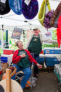 The Portland Farmers' Market in the South Park Blocks on Saturday mornings.  SuDan Farms, run by Susie and Dan Wilson, offer grass-fed lamb and premium wool together at the market.  Every Saturday, Susie hand spins the yard for customers.