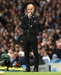 """Manchester City manager Pep Guardiola on the touchline during the Premier League match at the Etihad Stadium, Manchester. PRESS ASSOCIATION Photo. Picture date: Sunday December 3, 2017. See PA story SOCCER Man City. Photo credit should read: Martin Rickett/PA Wire. RESTRICTIONS: EDITORIAL USE ONLY No use with unauthorised audio, video, data, fixture lists, club/league logos or """"live"""" services. Online in-match use limited to 75 images, no video emulation. No use in betting, games or single club/league/player publications."""