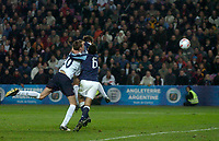 Photo: Glyn Thomas.<br />England v Argentina. International Friendly. 12/11/2005.<br />England's Michael Owen (obscured) gives his team a 3-2 win.