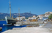 Cargo ship freighter at quayside in the port harbour at Calvi, Corsica, France in late 1950s