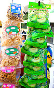 Snack packages of Guava flavor candy and fried pork skins and ear. Hmong Sports Festival McMurray Field St Paul Minnesota USA