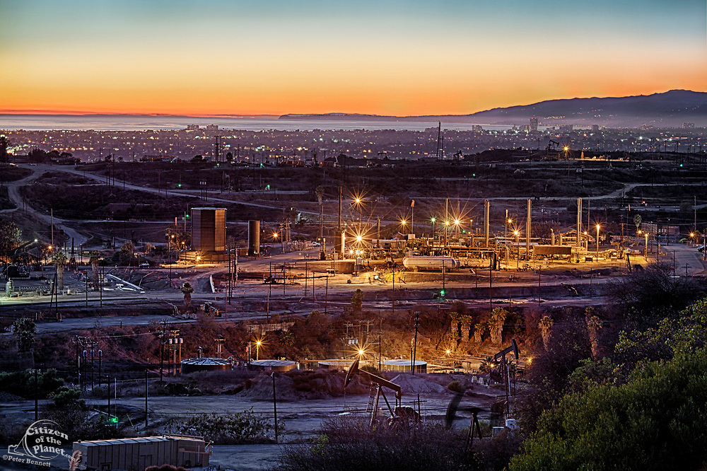Inglewood Oil Field, one of the largest urban oil fields in the country, with city of Santa Monica and Malibu coastline in the background.