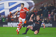 Daniel Pinillos of Barnsley (23) skips past Lee Cattermole of Sunderland (6) during the EFL Sky Bet League 1 match between Barnsley and Sunderland at Oakwell, Barnsley, England on 12 March 2019.