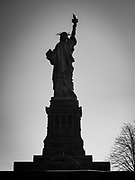 Black and white rear view photo of the Statue of Liberty in New York City