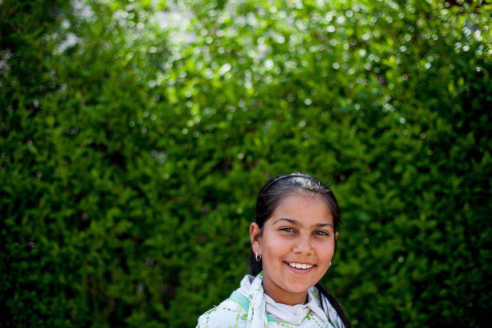 Portrait of a girl from the local Roma community in the Roma part of the city Vinica in Macedonia.