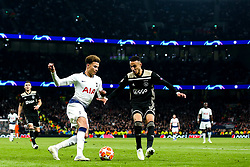 Dele Alli of Tottenham Hotspur takes on Noussair Mazraoui of Ajax - Mandatory by-line: Robbie Stephenson/JMP - 30/04/2019 - FOOTBALL - Tottenham Hotspur Stadium - London, England - Tottenham Hotspur v Ajax - UEFA Champions League Semi-Final 1st Leg
