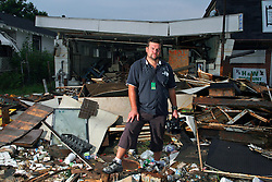 24 August 2006 - New Orleans - Louisiana. <br /> Lower 9th ward. Australian tourist and hurricane Katrina survivor Bud Hopes (33yrs - Brisbane) returns to the city almost a year after he was caught up in hurricane Katrina. Bud was amongst the tourists evacuated to the Superdome during the storm. Bud emerged as the 'leader' of the tourist group of some 70 foreign tourists caught up in the hell that was the Superdome in the days after the storm last year. Bud is shocked to discover the lack of action amidst the debris of the still ruined Lower 9th Ward.<br /> Photo; Charlie Varley/varleypix.com