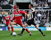 Photo. Andrew Unwin, Digitalsport<br /> Newcastle United v Middlesbrough, Barclays Premiership, St James' Park, Newcastle upon Tyne 27/04/2005.<br /> Newcastle's Andy O'Brien (R) looks to tackle Middlesbrough's Szilard Nemeth (L).