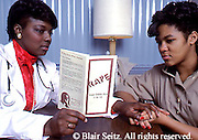 Medical, Counseling, African American Therapist and Female Teenager, Rape Prevention, Planned Parenthood Clinic