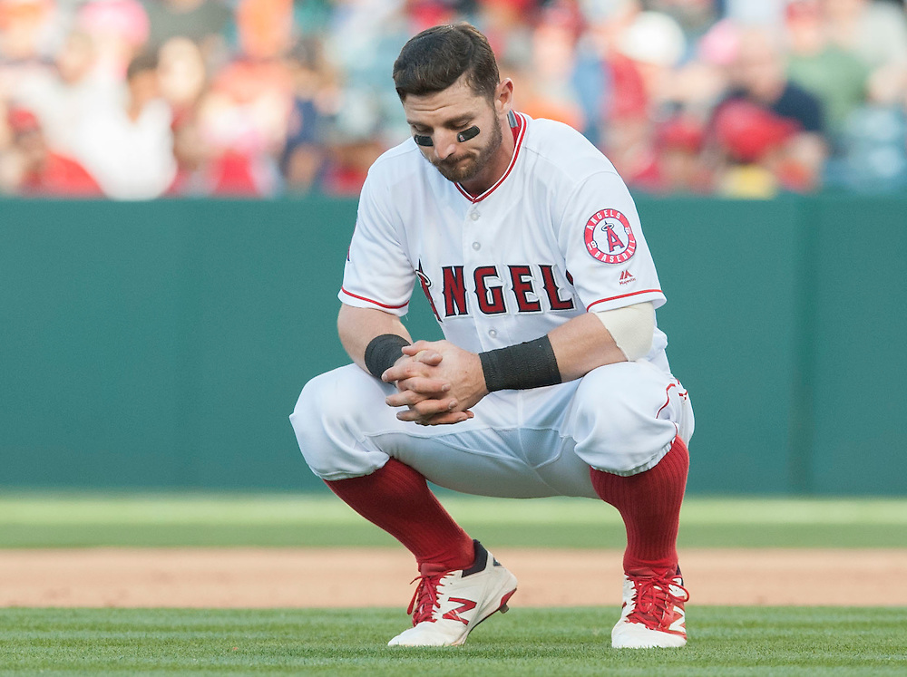 The Angels' Johnny Giavotella squats on the field after grounding out with two on to end the eighth inning during the Angels' 3-0 loss to the Detroit Tigers Wednesday at Angel Stadium.<br /> <br /> ///ADDITIONAL INFO:   <br /> <br /> angels.0602.kjs  ---  Photo by KEVIN SULLIVAN / Orange County Register  -- 6/1/16<br /> <br /> The Los Angeles Angels take on the Detroit Tigers Wednesay at Angel Stadium.
