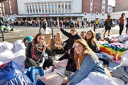 © Licensed to London News Pictures. 29/10/2017. London, UK.  Italian fans of singer, Harry Styles, pose for a photo outside the Hammersmith Eventim Apollo in West London ahead of his first UK solo shows taking place on 29 and 30 October.  Many fans, eager to secure a space as close to the stage as possible have queued overnight, sleeping on the pavement in their sleeping bags or under duvets.  Fans immediately outside the entrance to the venue will be seeing the singer perform on the 29 October, whilst those under the nearby Hammersmith flyover (pictured) have arrived a day early with tickets for 30 October.  Photo credit: Stephen Chung/LNP