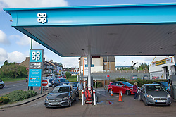 © Licensed to London News Pictures 29/09/2021.<br /> Swanley, UK, The petrol shortage continues today with motorists queuing for hours at this Co-op petrol station in Swanley, Kent. This station only had unleaded left at two pumps at 10.30am, staff said the station will be empty within two hours. Photo credit:Grant Falvey/LNP