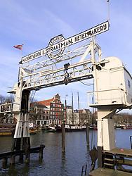 Historic crane in harbour at Dordrecht in The Netherlands