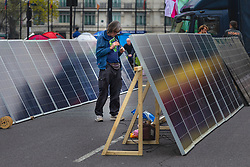 A solar panel array provides power for phone charging and sound systems as hundreds of environmental protesters from Extinction Rebellion occupy Marble Arch, camping in the square and even on the streets, blocking access to traffic on Park Lane and Oxford Street in London's usually traffic-heavy west end. . London, April 16 2019.