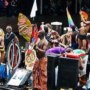 NLD/Amsterdam/20100807 - Boten tijdens de Canal Parade 2010 door de Amsterdamse grachten. De jaarlijkse boottocht sluit traditiegetrouw de Gay Pride af. Thema van de botenparade was dit jaar Celebrate, Afrikaanse homo's