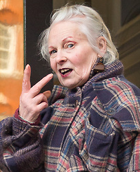 © Licensed to London News Pictures. 04/02/2016. London, UK. Dame Vivienne Westwood gestures to reporters as she arrives at the Ecuador embassy in London where WikiLeaks founder Julian Assange is currently living.  A United Nations panel is due to decide if Julian Assange has been kept in 'unlawful detention' during his stay at the embassy for the past three-and-a-half-years. Photo credit: Peter Macdiarmid/LNP