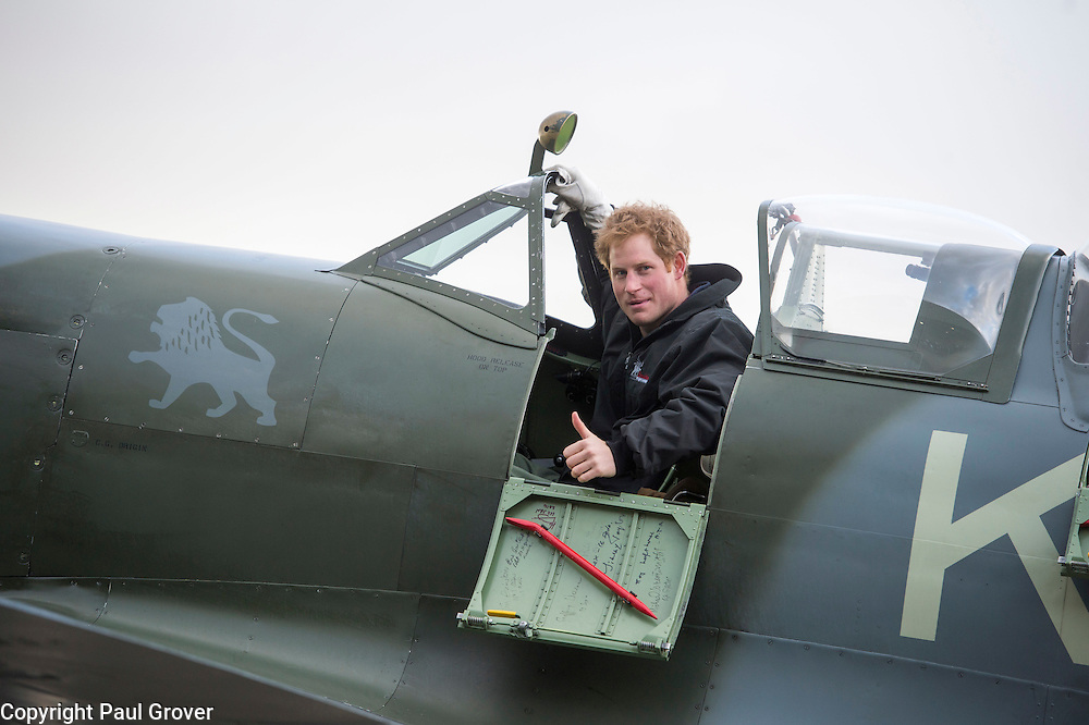 Mcc0052952.ST News.Rota.Boultbee Flying Academy. Goodwood Aerodrome.HRH Prince Harry visits the Boultbee Flying Academy where he met Prince Harry , met Battle of Britain veterans, viewed the spitfire in the hangar and weather-permitting, boarding the spitfire