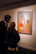 """Curious buyers look at """"Les Marrionnettes"""" by artist Françoise Gilot at the Vincent Mann Gallery in New Orleans."""