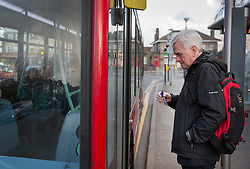 © Licensed to London News Pictures. 16/03/2016. London, UK.  Labour Shadow Chancellor John McDonnell waits to board a bus as he heads for Parliament on Budget day. Later Chancellor George Osborne will deliver his eighth budget to MPs.  Photo credit: Peter Macdiarmid/LNP