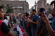 Evening prayers in Tahrir Square in Cairo behind the women's area infront of the stage during another sit-in supporting the military takeover of the country.
