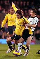 Photo: Ed Godden.<br /> Fulham v Arsenal. The Barclays Premiership. 29/11/2006.<br /> Arsenal's Tomas Rosicky (L) is challenged from behind by Tomasz Radzinski.