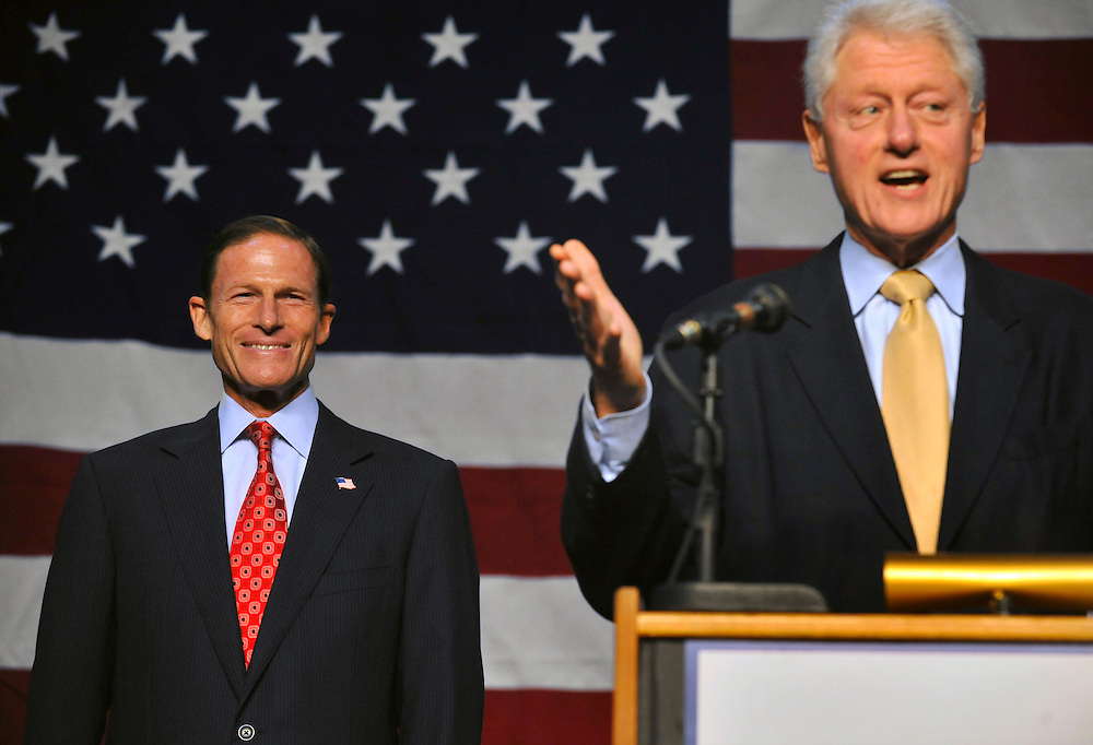 Democratic U.S. Senate candidate Richard Blumenthal, left, smiles while former President Bill Clinton speaks on his behalf in New Haven, Conn., on Sunday, Sept. 26, 2010.  (AP Photo/Jessica Hill)