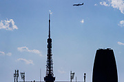 A jet airliner flies low over Tokyo Tower Tokyo, Japan. Wednesday February 5th 2020. .Starting on February 2nd, the  Japanese government is  testing a new flight path to Haneda Airport that will, increase the airports capacity in preparation for the 2020 Tokyo Olympics. The new route allows airliners, for the first time, to approach Haneda over central Tokyo. The route is  set to open on March 23rd  despite fears from residents under about noise and  safety issues.