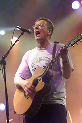Craig of The Proclaimers on stage two, T in the Park, Balado, Fife, 7/7/2001..©2010 Michael Schofield. All Rights Reserved.