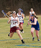 Concord's  Veronyca Daniels and Londonderry's Jenna Conroy charge down field during Tuesday's NHIAA Division I Lacrosse.  (Karen Bobotas/for the Concord Monitor)