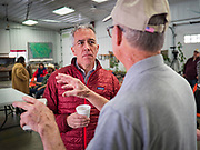 "24 JANUARY 2020 - POLK CITY, IOWA: JOE WALSH, (red jacket) talks to RAY MEYLOR about regenerative agriculture on Meylor's farm in Polk City, northwest of Des Moines. Walsh, a conservative radio personality, former Republican congressman, and one time supporter of Donald Trump is now challenging Trump for the Republican nomination for the US Presidency. During his appearance in Polk City, Walsh said Trump is unfit to be the President because he is a ""cheater,"" a climate change denier, and a ""threat"" to the United States.      PHOTO BY JACK KURTZ"