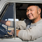 Driver in window of 4WD Russian tourist van (Gorkhi-Terelj national park, Mongolia - Sep. 2008) (Image ID: 080917-1646211a)