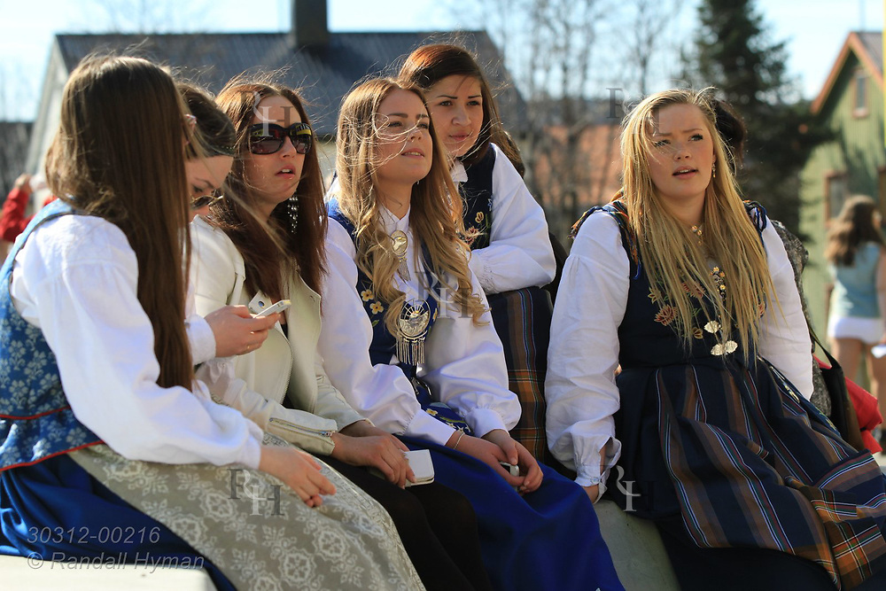 Young women wear bunads (national costumes) for May 17th Constitution Day celebration of nation's independence in Kirkenes, Norway.