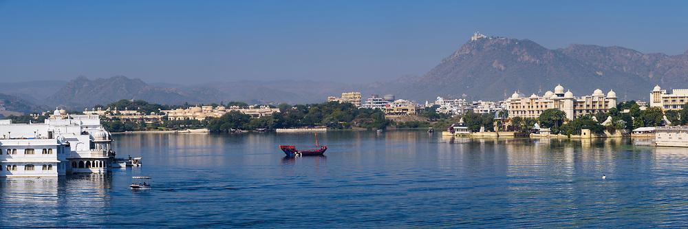 UDAIPUR, INDIA - CIRCA NOVEMBER 2016:  Panoramic view of  Lake Pichola and Lake Palace Hotel formerly known as Jag Niwas in Lake Pichola in Udaipur