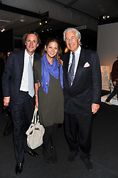 Left to right, ALEX PETO, GEMMA THOMAS and MARTIN SUMMERS at a 2nd private view of the Pavilion of Art & Design London 2011 held in Berkeley Square, London on 11th October 2011.