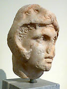 Head of Alexander the Great.  Pentelic marble found in the Kerameikos, Athens.  The letters on Alexander's face were carved at a later period.  About 300 BC.